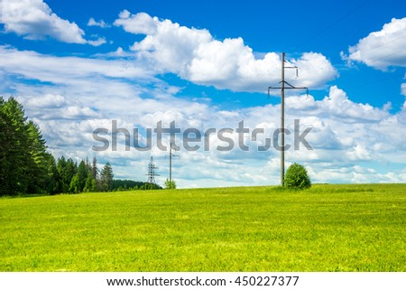 Powerlines on the green field. Country landscape
