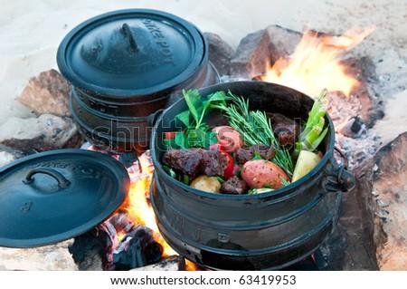poyke pot on the fire - stock photo