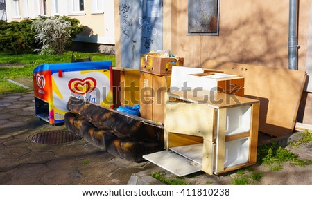 POZNAN, POLAND - APRIL 25, 2016: Old furniture standing by apartment buildings on a sunny day - stock photo