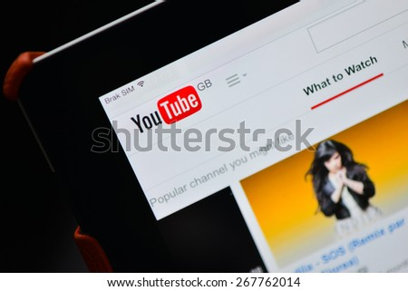 Poznan, Poland - April 08, 2015 : YouTube GB website home page on Ipad display. YouTube is the popular online video-sharing website, founded in February 14, 2005.  - stock photo