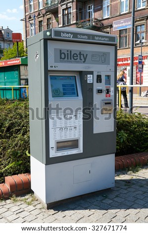 POZNAN, POLAND - AUGUST 20, 2015: Public transport ticket vending machine in the street - stock photo