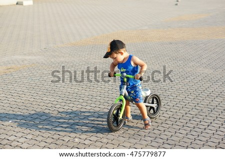 POZNAN, POLAND - AUGUST 28, 2016: Unidentified two years old boy sitting on a bicycle