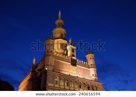 Poznan, Poland - city architecture. Greater Poland province (Wielkopolska). Famous old City Hall at main square (Rynek). Evening view. - stock photo