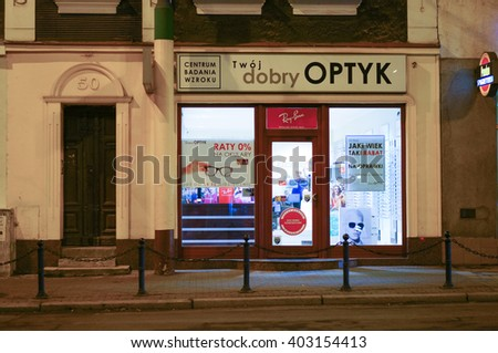 POZNAN, POLAND - DECEMBER 05, 2013: Entrance to a optician salon in the city center by night
