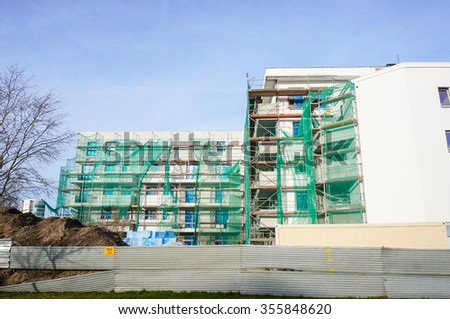 POZNAN, POLAND - DECEMBER 27, 2015: New apartment building under construction at the Stare Zegrze area - stock photo