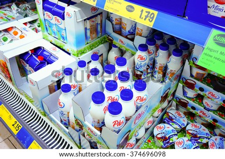 POZNAN, POLAND - DECEMBER 08, 2013: Variation of milk products in a fridge for sale in a supermarket - stock photo