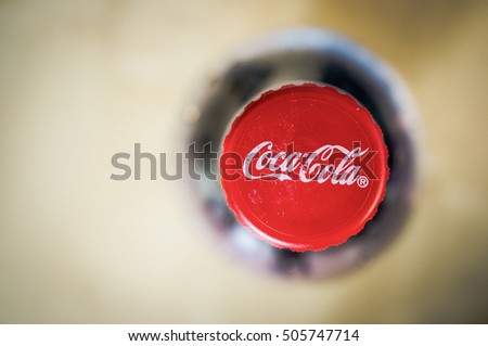 POZNAN, POLAND - FEBRUARY 02, 2014: Close-up of a red Coca Cola bottle cap