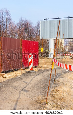POZNAN, POLAND - FEBRUARY 28, 2016: Footpath with grid barrier on a construction area