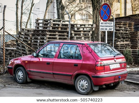 POZNAN, POLAND - FEBRUARY 24, 2014: Red parked Skoda Felicia