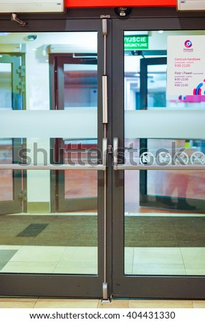 POZNAN, POLAND -  JANUARY 19, 2014: Emergency exit doors in the Poznan City Center shopping mall - stock photo