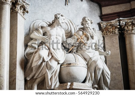 POZNAN, POLAND - JANUARY 23, 2017: Sculpture of two men holding a holy cross in the Archcathedral Basilica of St. Peter and St. Paul on the island of Ostrow Tumski