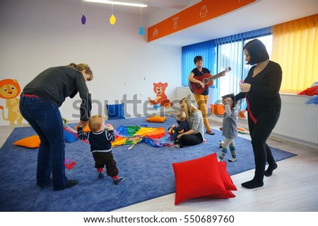POZNAN, POLAND - JANUARY 07, 2017: Unidentified adults and children creating a circle during classes in a music school