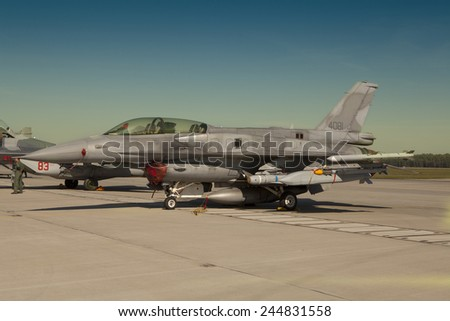 POZNAN, POLAND - JULY 11, 2014:F-16 Fighting Falcon is a single-engine multirole fighter aircraft originally developed by General Dynamics.  - stock photo