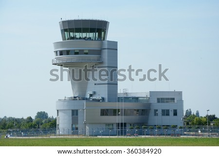 Poznan, Poland - June 18, 2015: Control tower on Poznan Lawica airport. Unidentified people visible.