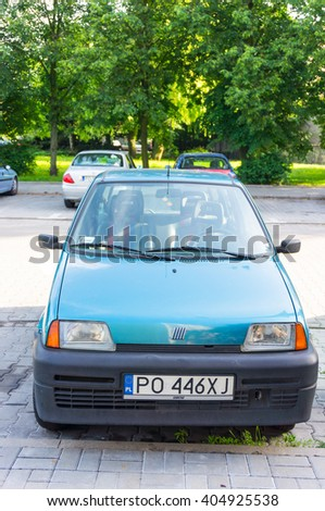 POZNAN, POLAND - JUNE 10, 2014: Parked old Fiat 500 by a sidewalk