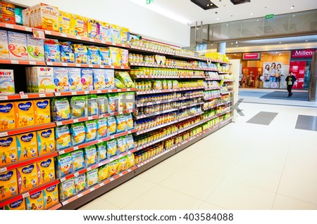 POZNAN, POLAND - JUNE 21, 2014: Variation of baby food for sale in a Rossman store - stock photo