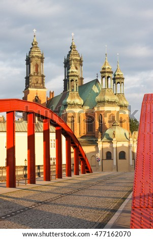 Poznan, Poland - June 29, 2016: View on old bridge and cathedral church of St. Peter and St. Paul in polish city Poznan on Ostrow Tumski square