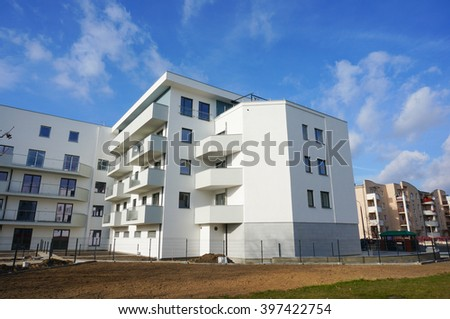 POZNAN, POLAND - MARCH 19, 2016: New build modern apartment building at the Stare Zegrze area - stock photo