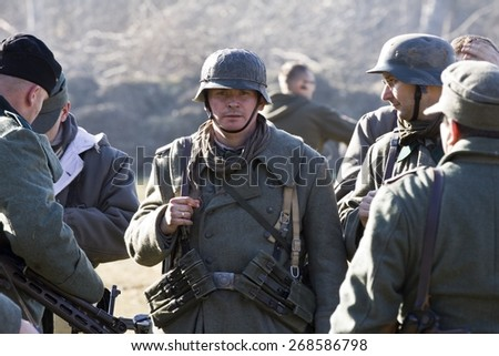 POZNAN, POLAND - MARCH 23, 2014: Re-enactment of the battle of the World War II. Anniversary of the liberation of the city of Poznan.  - stock photo