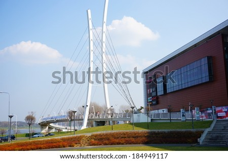 POZNAN, POLAND - MARCH 31, 2014: Small bridge leading to the Galeria Malta shopping mall