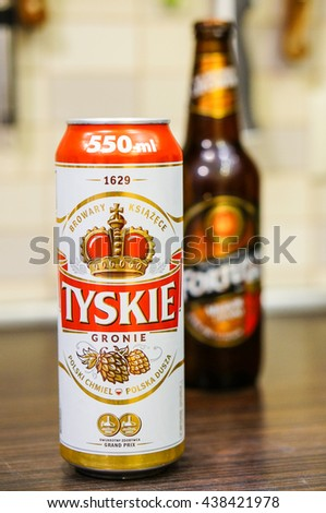 POZNAN, POLAND - MAY 25, 2016: Polish Tyskie beer in a can standing on table - stock photo