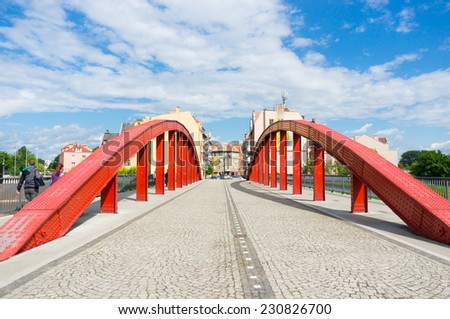 POZNAN, POLAND - MAY 30, 2014: Red bridge road at the center of the city - stock photo