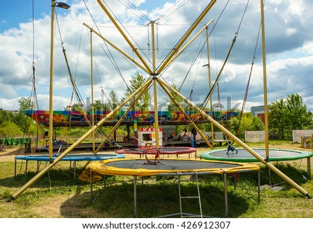 POZNAN, POLAND - MAY 15, 2016: Three jump trampolines at a luna park on a sunny day