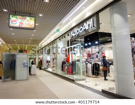 POZNAN, POLAND - NOVEMBER 29, 2013: Entrance to a KappAhl clothing store in the Galeria Malta shopping mall - stock photo