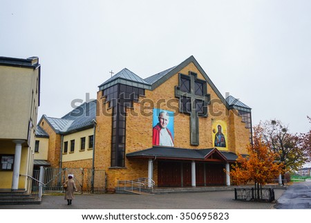 POZNAN, POLAND - NOVEMBER 07, 2015: Exterior of a church with Pope picture at the Orla Bialego area on a cloudy day