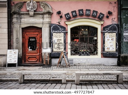POZNAN, POLAND - NOVEMBER 30, 2013: Front of a Dramat restaurant on the old square