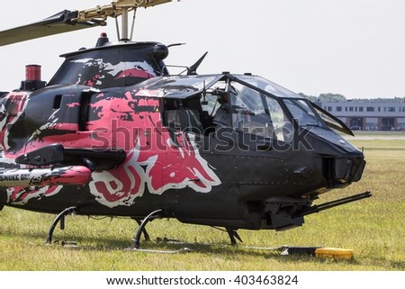 POZNAN, POLAND -SEP 23, 2015: The Bell AH-1 Cobra is a two-blade, single engine attack helicopter manufactured by Bell Helicopter. - stock photo