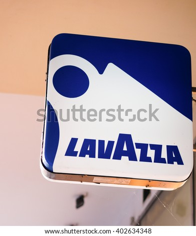 POZNAN, POLAND - SEPTEMBER 21, 2013: Lavazza coffee sign on a building - stock photo