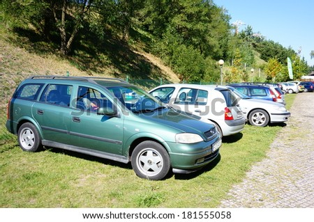 POZNAN, POLAND - SEPTEMBER 07, 2013: Many parked cars at a park on a sunny day