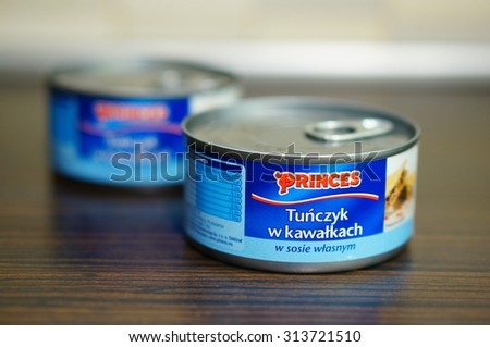 POZNAN, POLAND - SEPTEMBER 06, 2015: Princes tuna in can on wooden table