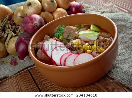 Pozole- traditional soup Mexico.broth rich soup made with pork, red chiles, radishes, cilantro - stock photo