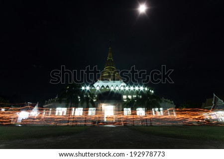 PRACHUAPKIRIKHAN THAILAND- MAY 13: Vesak day. Buddhists with candlelight  to walk round is the important measure.On MAY 13, 2014.
