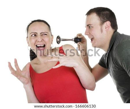 practical joke, surprised woman being shocked by man with horn - stock photo