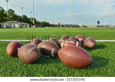 practice balls on football field - stock photo