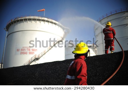 practice fireman extinguish oil spill petrochemical industrial.