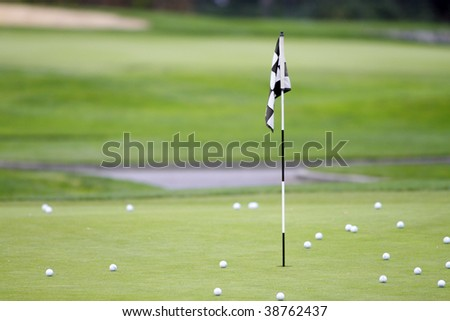 Practice green with compliment of practice balls - stock photo