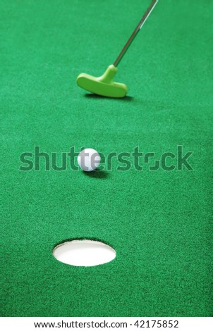 practice putting - stock photo