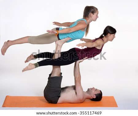 Practicing Acro Yoga Exercises In Group People Doing Studio On White Background