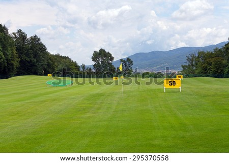 Practicing range at a golf course, with table marking 50 meters - stock photo