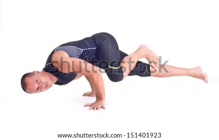 Practicing Yoga exercises. Man doing  Yoga exercises in studio on white background.  Pose name: Challenge Pose - Koundiyanasana