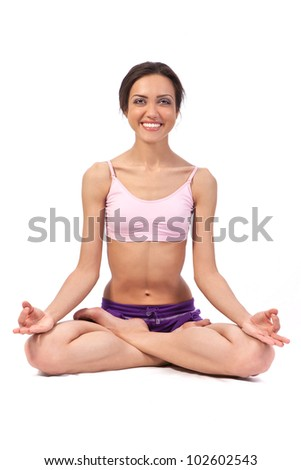 Practicing Yoga. Lotus. Young woman isolated on white background