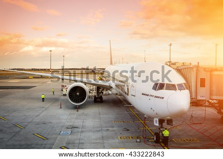 PRAGUE - April 7, 2016: Emirates Boeing 777-300 ER at Vaclav Havel Airport Prague on April 7, 2016, boarding passengers in beautiful sunset