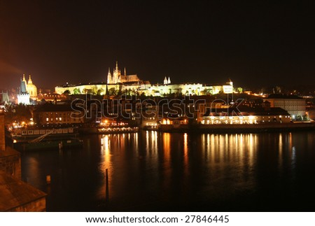 Prague at night, with castle and cathedral across the Moldau