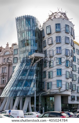 PRAGUE - 2015 AUGUST 22:  Modern building, also known as the Dancing House, designed by Vlado Milunic and Frank O. Gehry stands on the Rasinovo Nabrezi. - stock photo