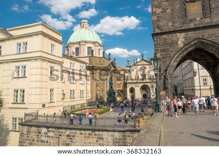 PRAGUE - AUGUST 5: People walking on the famous Charles Bridge, completed in 1400 and is 515 meters long  on august 5,2015 in Prague - Czech Republic