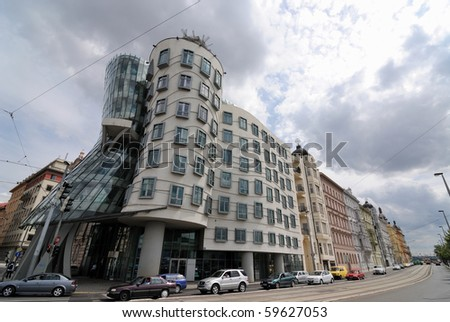 PRAGUE - AUGUST 2: The modern architectural curves of the Dancing House designed by Frank Gehry and Vlado Milunic August 2, 2010 in Prague, Czech Republic. - stock photo